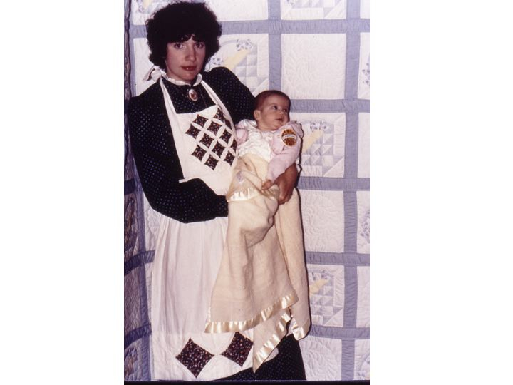 My mother, in 1980, with a newly born me. She won a blue ribbon. She's wearing a hand-sewn patchwork apron. How is that I am wrapped in a non-quilted blanket?! Sacrilege!